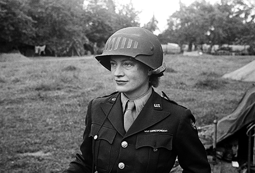 Copyright_LeeMillerArchives_Lee_Miller_wearing_special_helmet_borrowed_f...