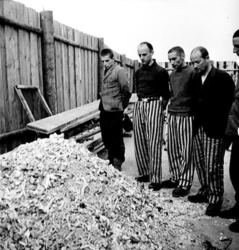 Copyright_LeeMillerArchives_Released_prisoners_in_striped_prison_dress_b...