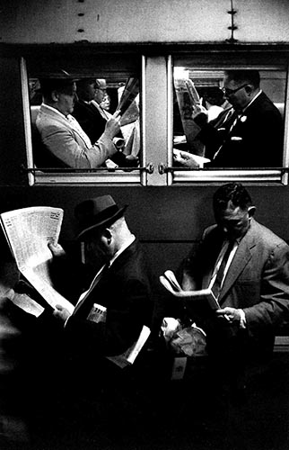 Louis-Stettner_Newspaper-Reader-in-Train_Penn-Station_New-York_1958