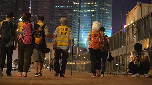 WP 59_Still_The _Thin Yellow Line_ Standing Between Hong Kong Police and Protesters_Dayu Zhang_South China Morning Post